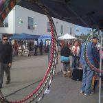 A fair booth full of hula hoops